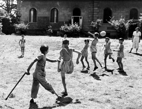 Pictured, boys who lost limbs in the war play, in Italy in 1950