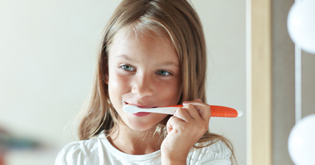 Girl brushes teeth