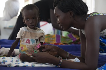 On 5 February, a woman plays with her 2-year-old son, Kuot Kune, at the UNICEF-supported Al-Shabbah Children's Hospital, where Kuot is being treated for severe acute malnutrition, in Juba, the capital. In late May 2015 in South Sudan, the lives of more than a quarter of a million children are at risk from a rapidly worsening nutrition situation. The environment for children has greatly deteriorated, based on the onset of an early lean season brought by ongoing conflict, diminished household food stocks and a declining economy. Children trapped by fighting, without access to basic medical services and food, will struggle to survive this lean season without an urgent resumption of humanitarian assistance in conflict-affected areas. Through the national Nutrition Scale Up programme and rapid response missions to remote, conflict-affected areas, UNICEF and partners have treated almost 50,000 children for severe acute malnutrition thus far in 2015. With a funding shortfall of 75 per cent this year, UNICEF is urgently appealing for US$25 million to continue its life-saving nutrition response in South Sudan.
